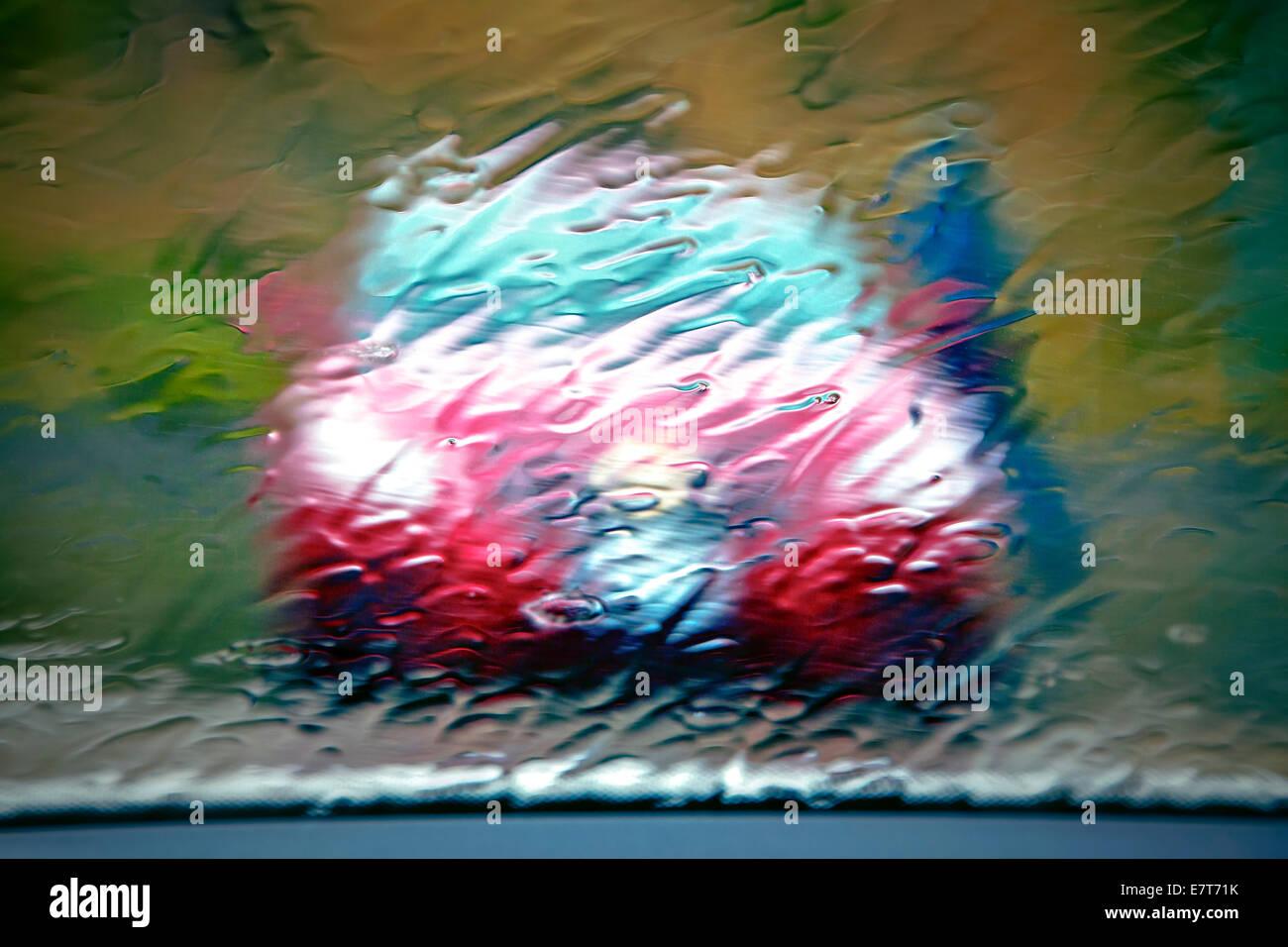 Car in rainstorm in pacific northwest. - Stock Image