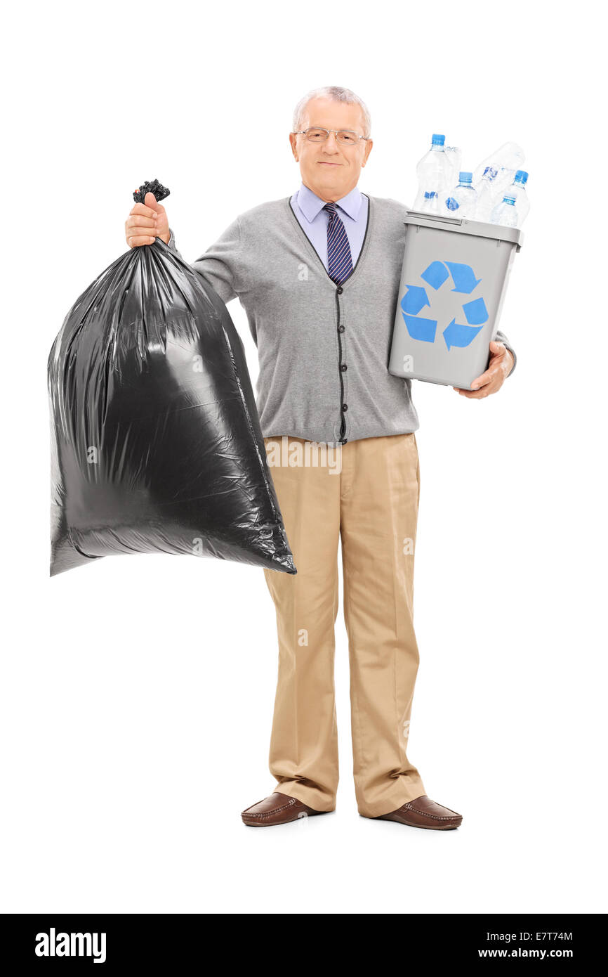 Full length portrait of a senior holding a recycle bin and a garbage bag isolated on white background - Stock Image