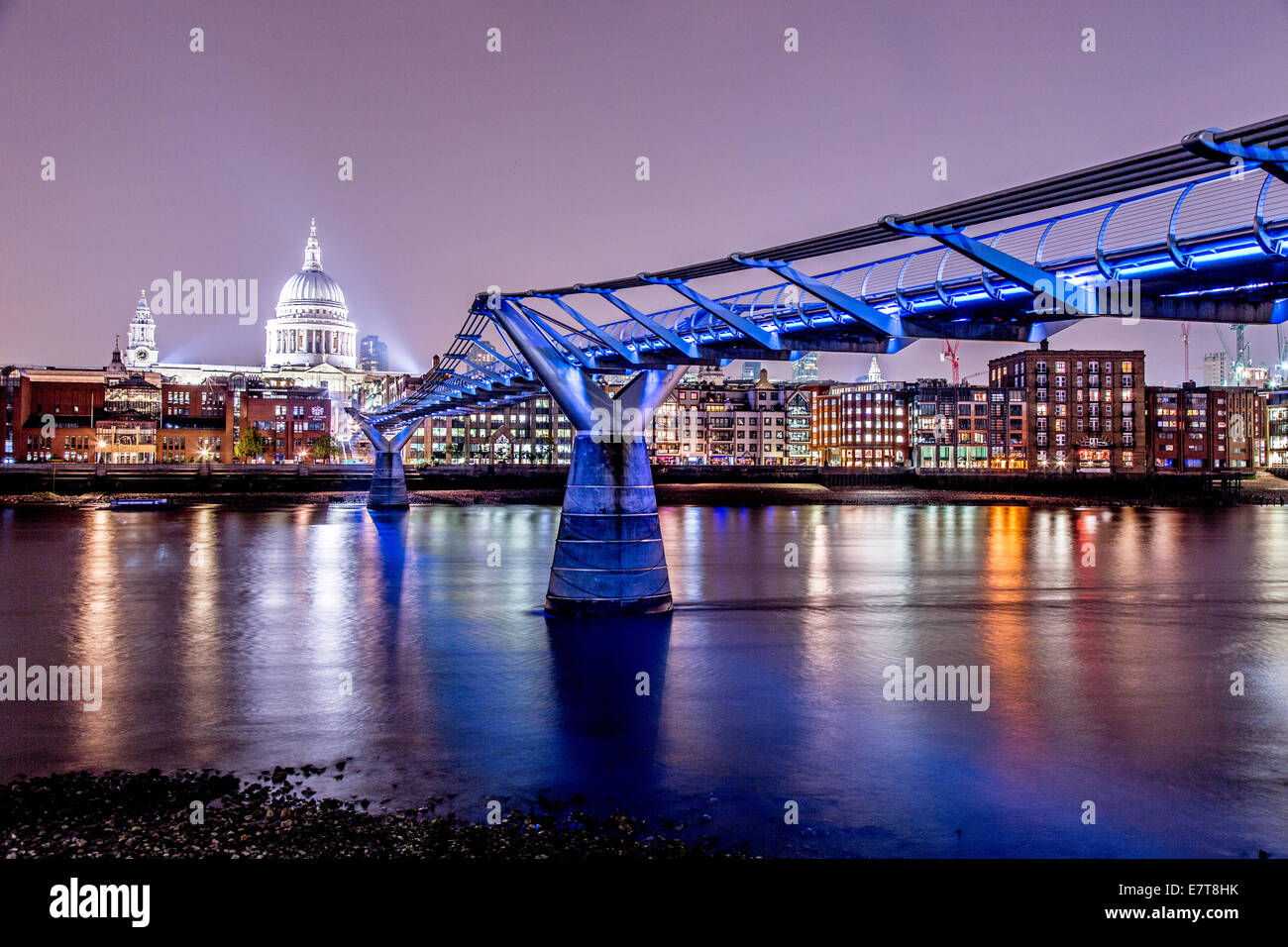 Millennium Bridge and St. Pauls Cathedral at Night London UK Stock Photo