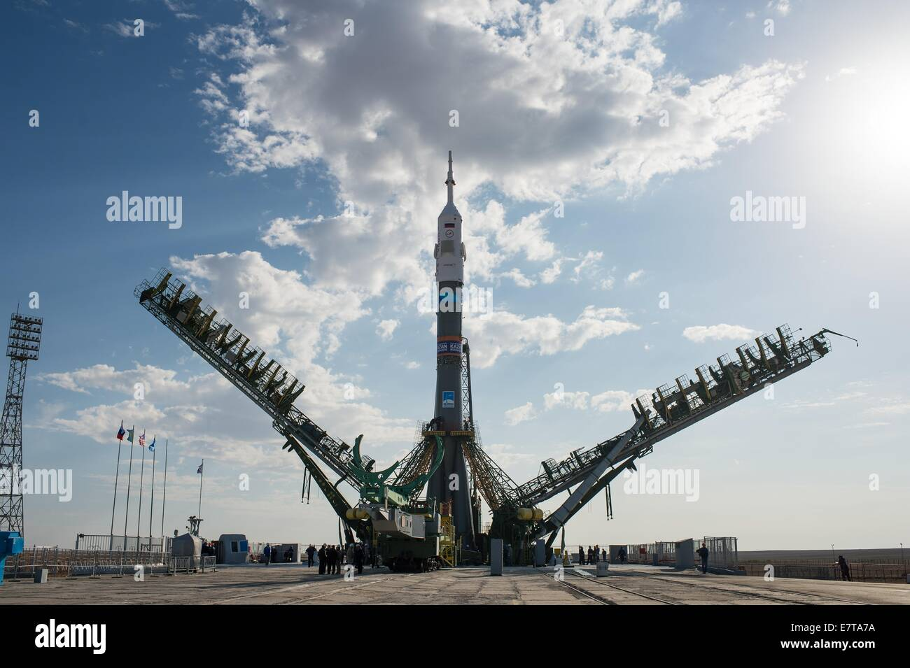 The gantry arms begin to close around the Soyuz TMA-14M spacecraft at the Baikonur Cosmodrome September 23, 2014 - Stock Image