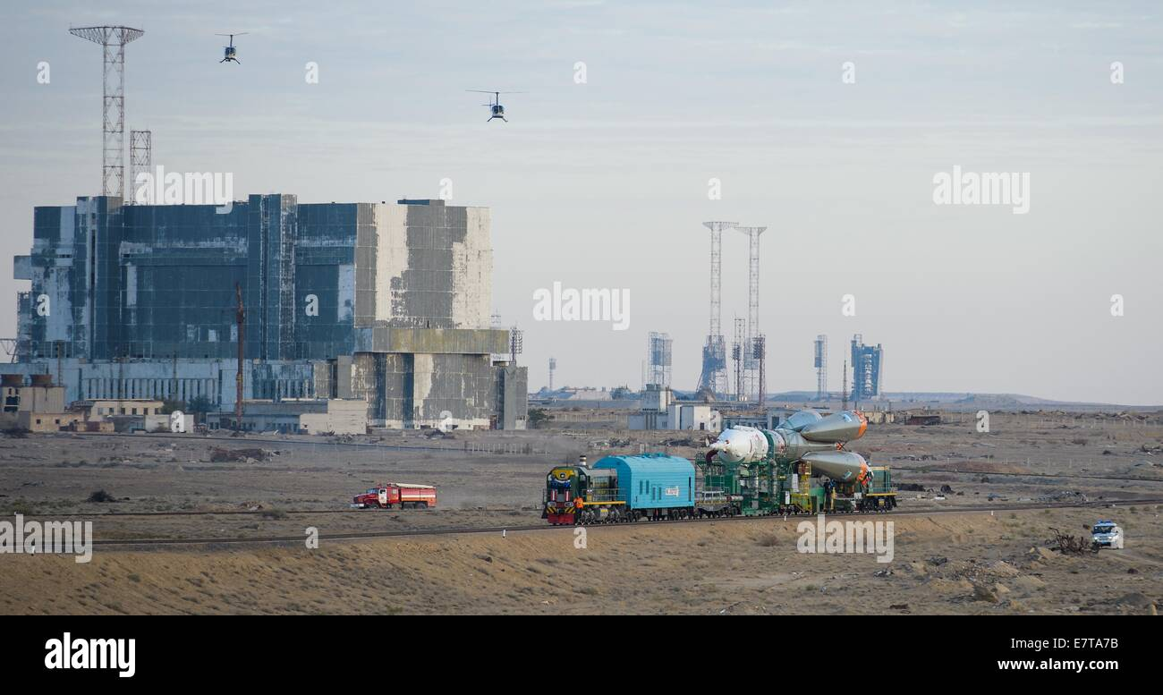 The Soyuz TMA-14M spacecraft rolls out to the launch pad by train at the Baikonur Cosmodrome September 23, 2014 - Stock Image