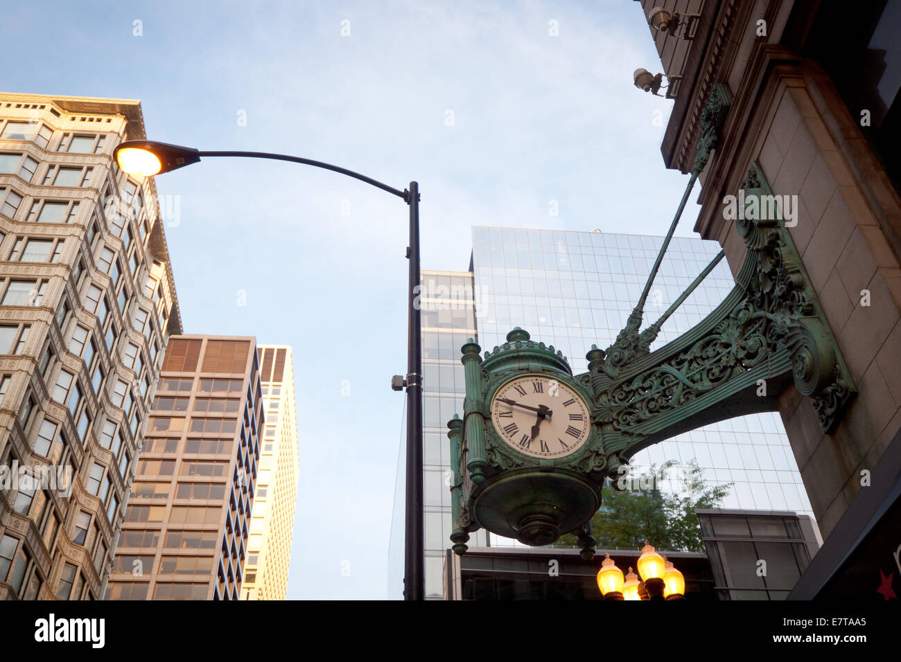 A famous, ornate clock outside of the Marshall Field and Company Building (Macy's at State Street) in the Loop - Stock Image