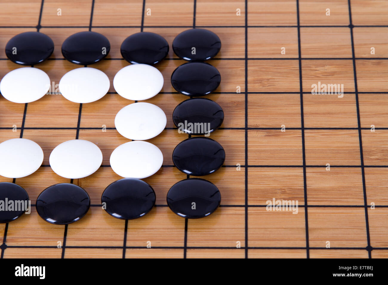 Close Up View Of Black And White Stone Pieces On Chinese Go Game Board