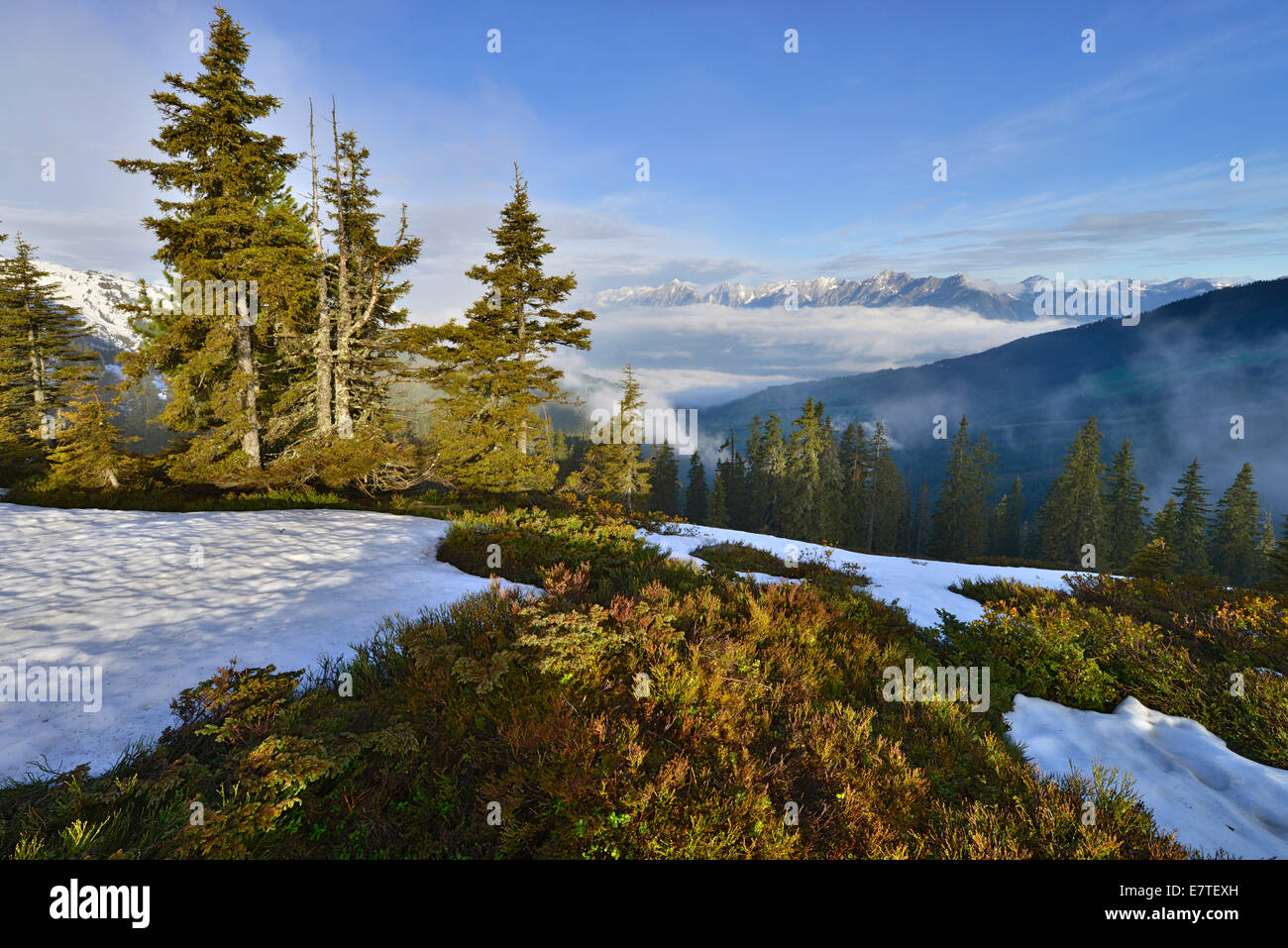 Mountain landscape with snow, at the back the Inn Valley and at the far back the Karwendel Range, from Mt Kleiner - Stock Image