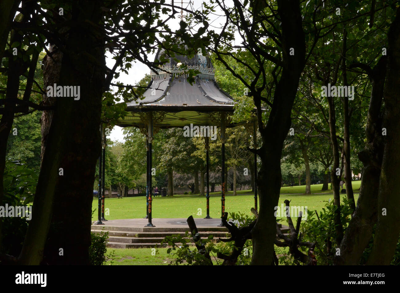 Overtoun Park host's a cast iron bandstand which was installed in 1914, it is in a very bad state of repair. - Stock Image