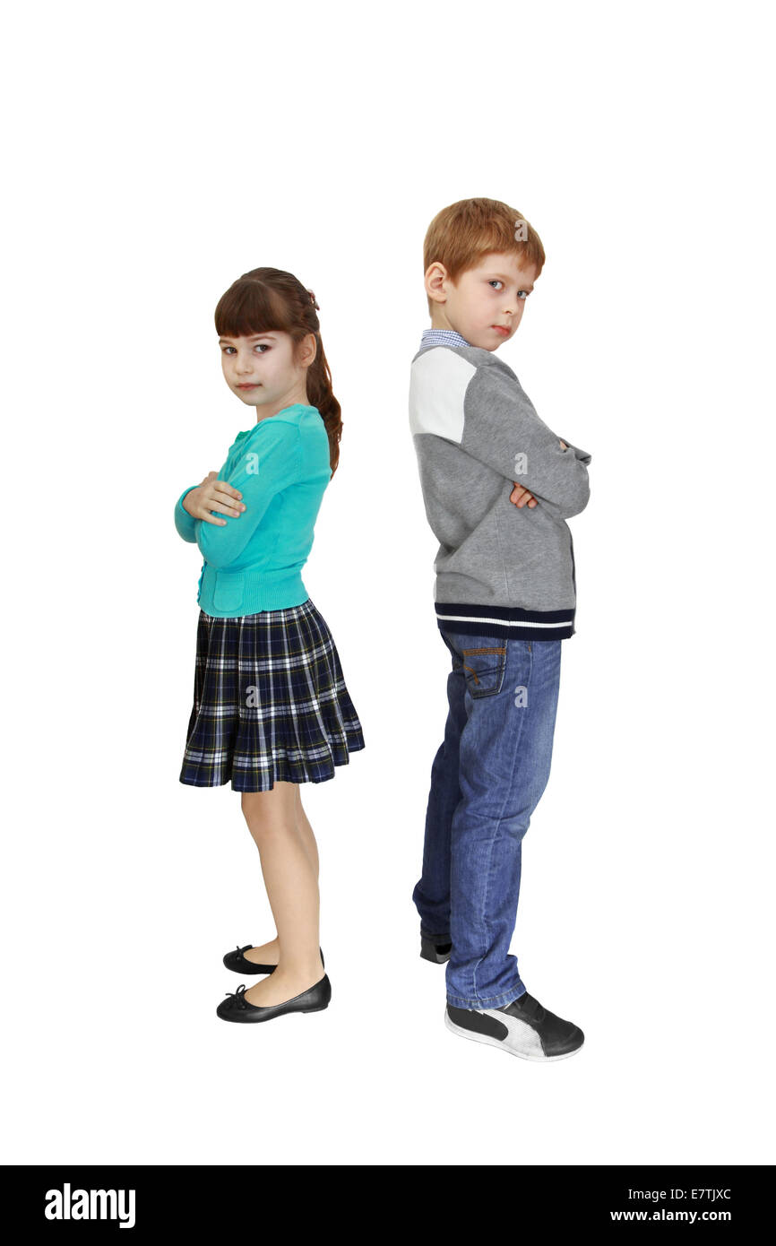 Boy and girl stand facing away from each other isolated on white background Stock Photo