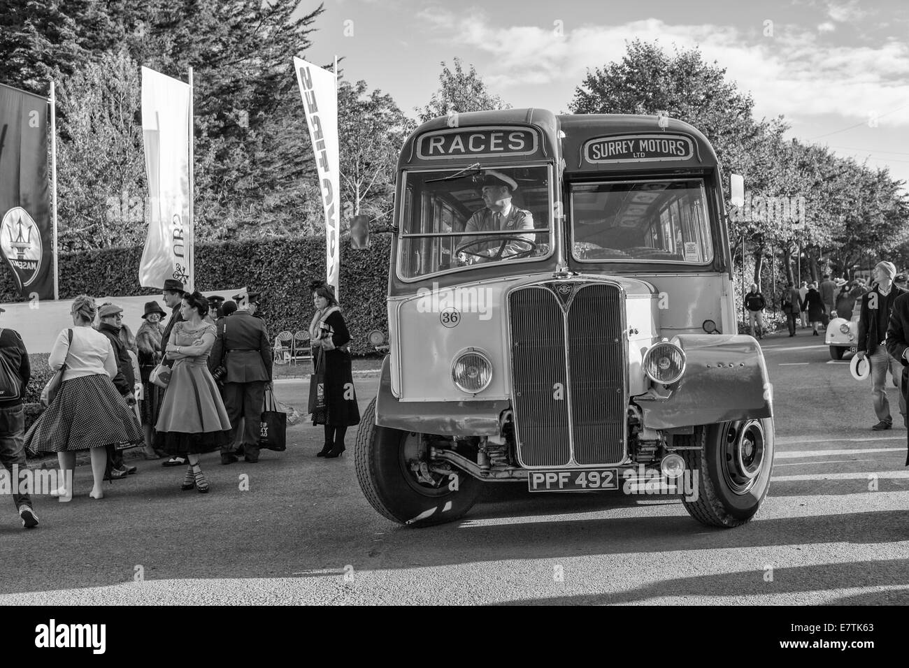 Old bus with ladies going to the races - Stock Image
