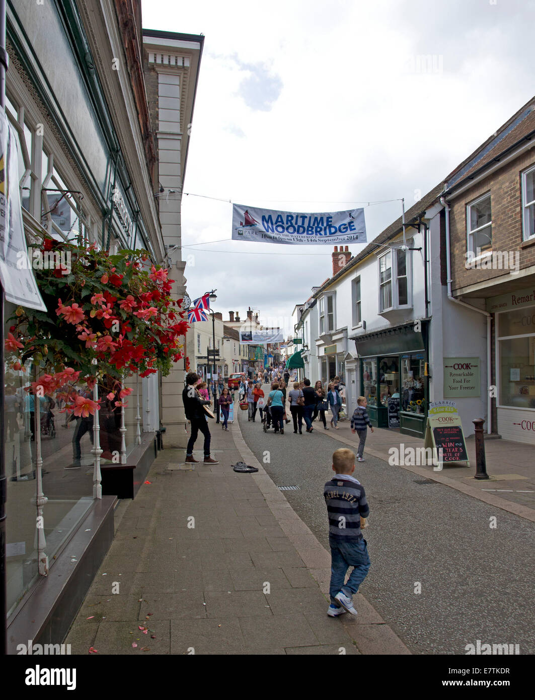 Woodbridge High Street on festival day at the end of summer - Stock Image