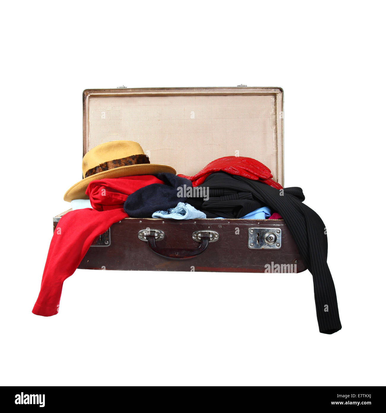 Vintage suitcase full of clothes isolated on white background - Stock Image