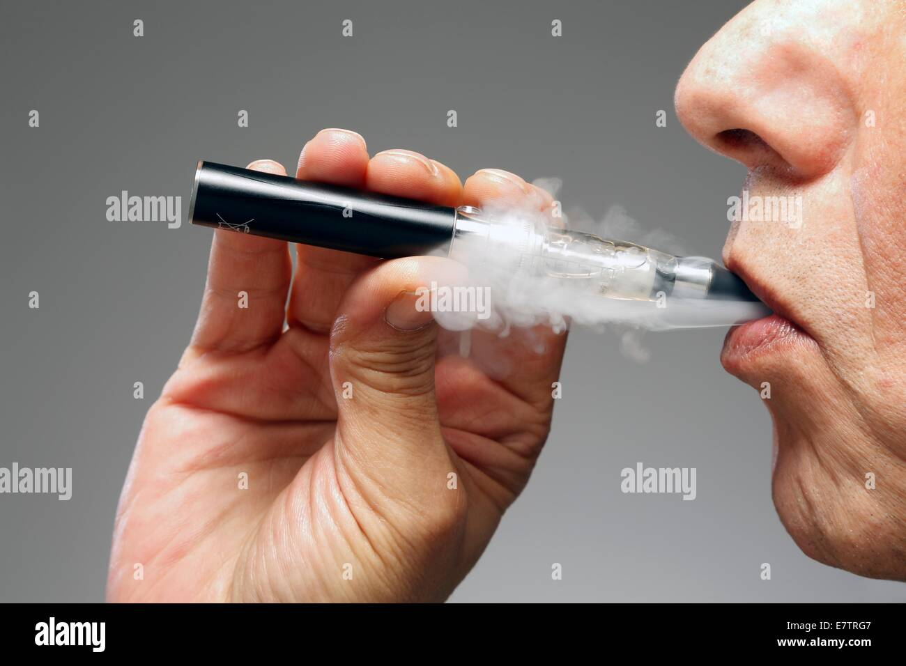 MODEL RELEASED. Person smoking e cigarette. - Stock Image