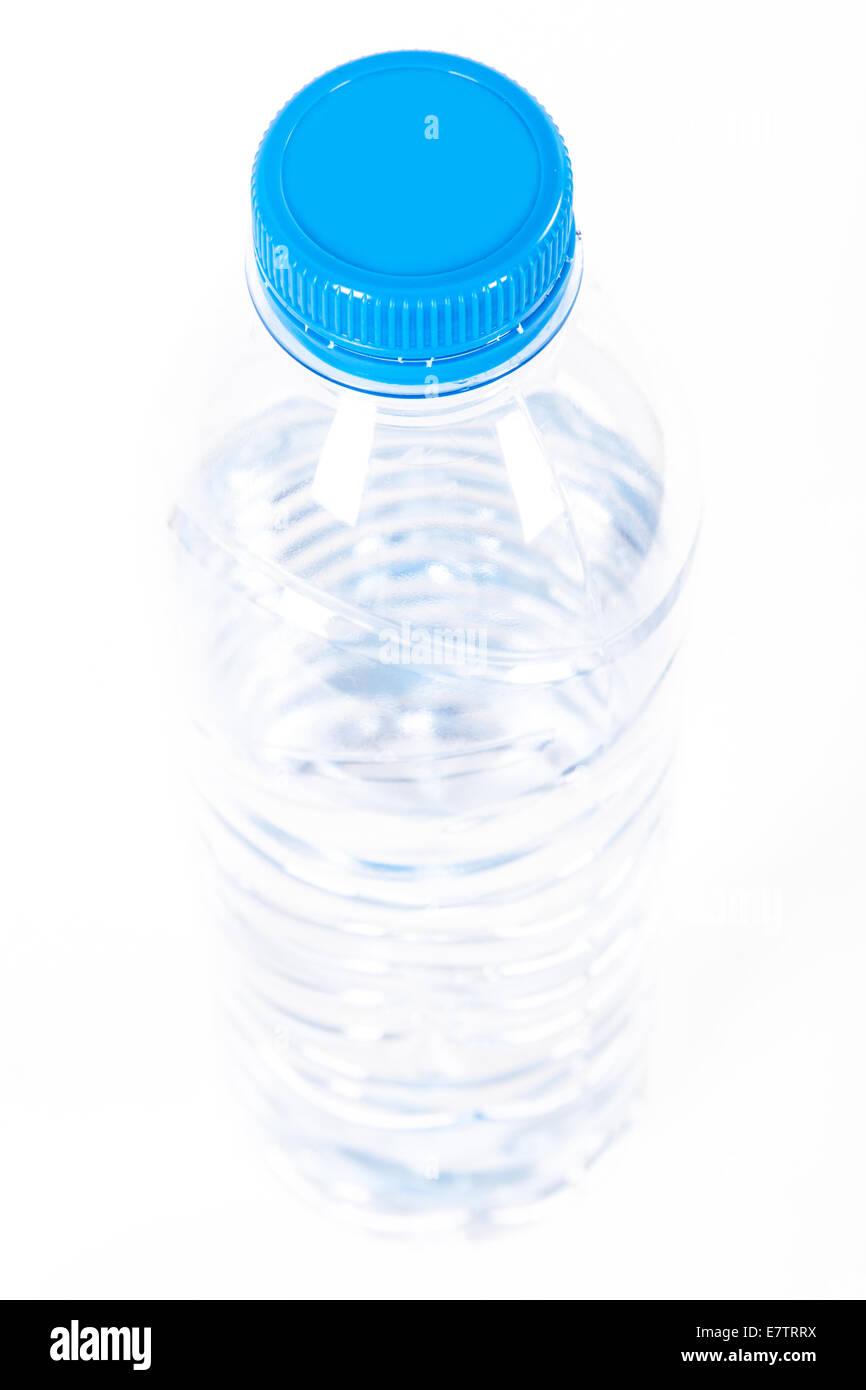 Plastic water bottle, isolated on white background. - Stock Image