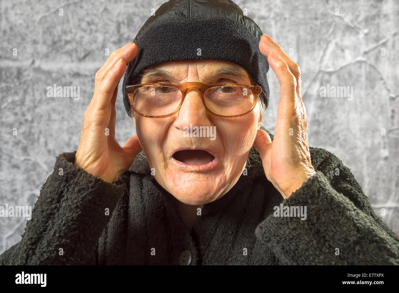 Portrait of scared and worried elderly woman. - Stock Image