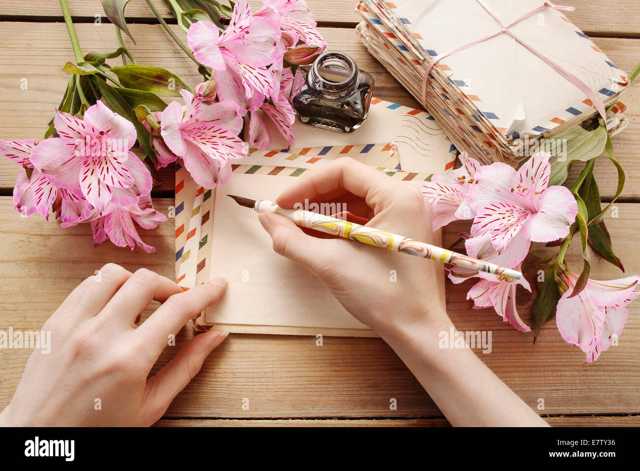 Woman writing a letter. Retro style - Stock Image