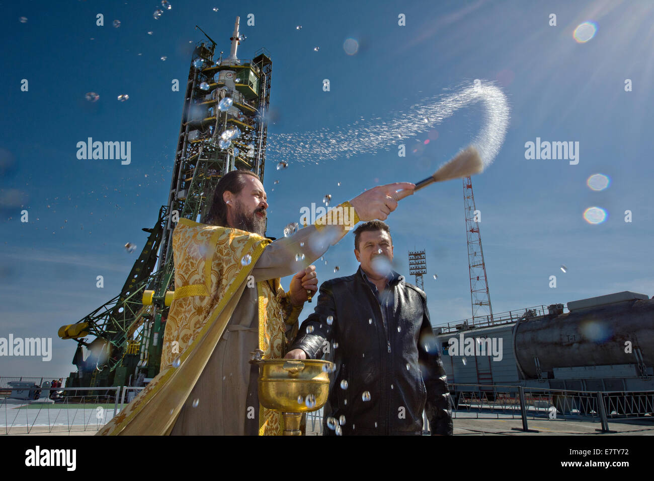 A Russian Orthodox priest blesses the Soyuz rocket on the launch pad at the Baikonur Cosmodrome September 24, 2014 Stock Photo