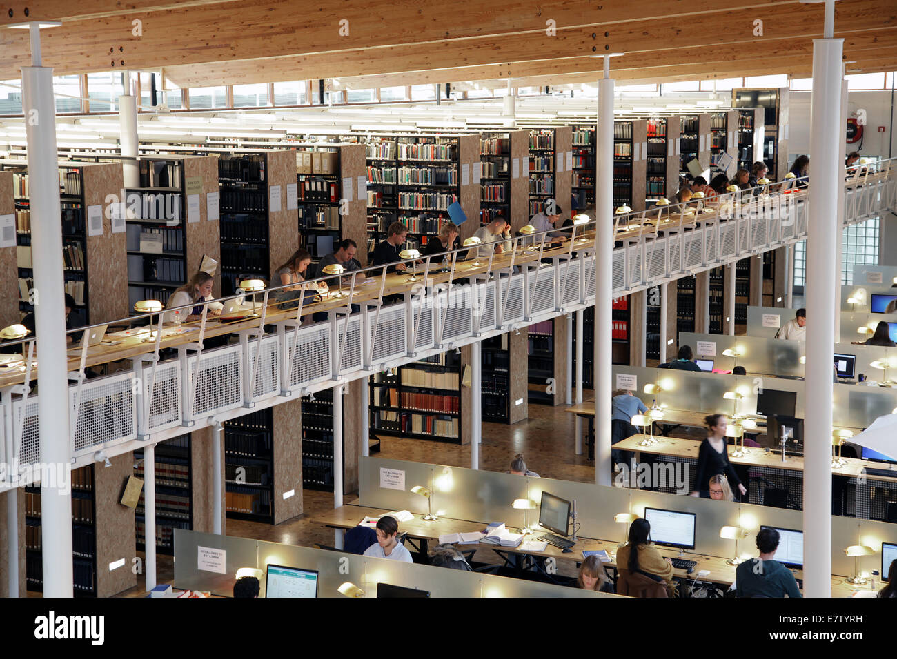 Student.Students reading studying and working in a Library.University Library. - Stock Image