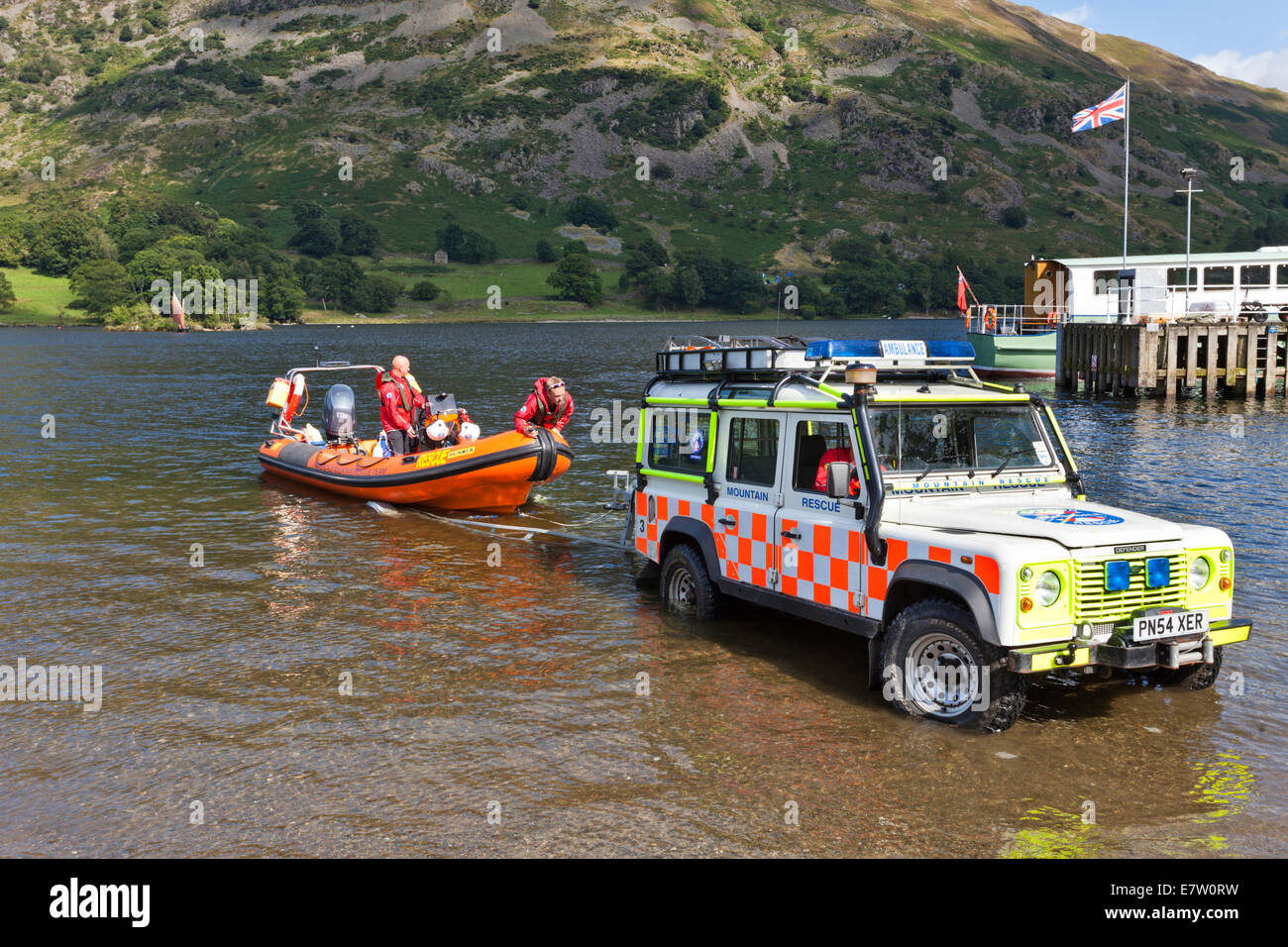 The English Lake District - The Patterdale Mountain Rescue Team setting out for a rescue at Glenridding on Ullswater, - Stock Image