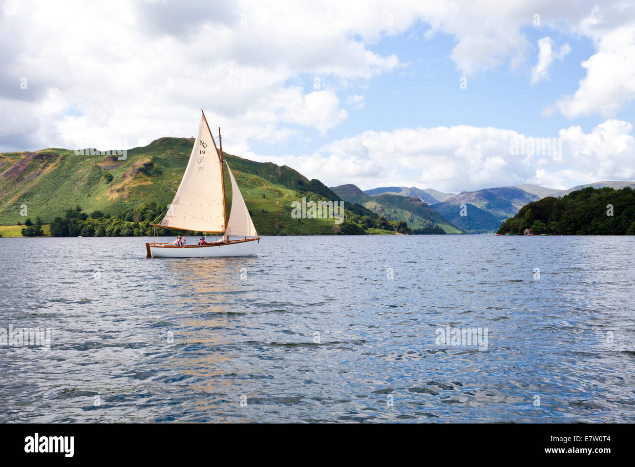 A sailing dinghy in the English Lake District on Ullswater, Cumbria UK - Stock Image