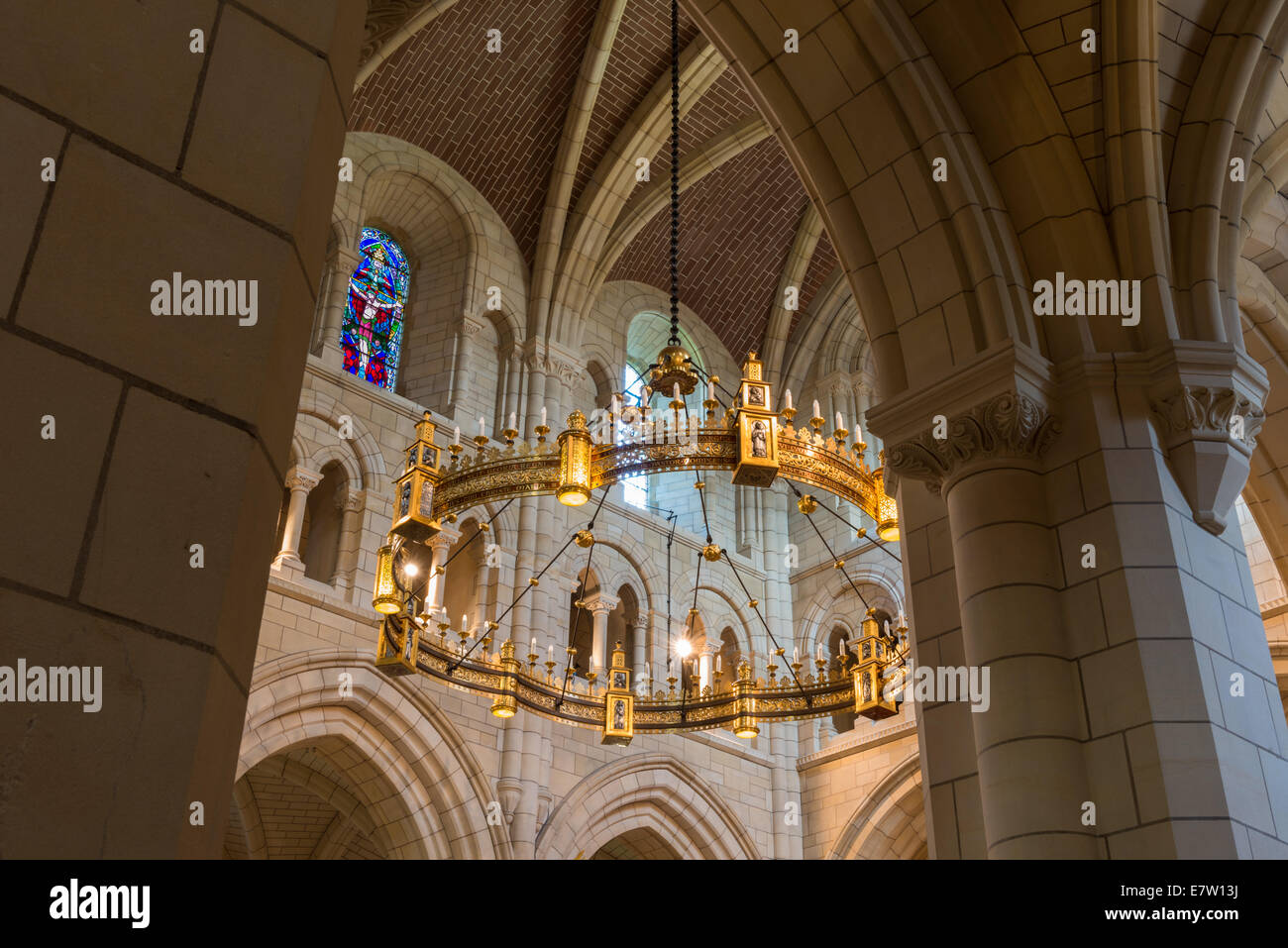 The interior of buckfast abbey hangs the chandelier corona lucis the interior of buckfast abbey hangs the chandelier corona lucis above the high altar and stained glass windows mozeypictures Images