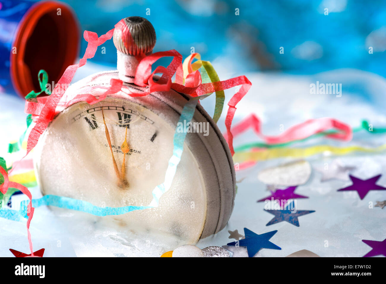 Watch frozen in ice.New year celebrations. - Stock Image