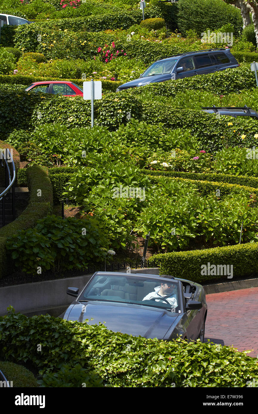 Ford Mustang convertable on Lombard Street, Russian Hill neighborhood, San Francisco, USA - Stock Image