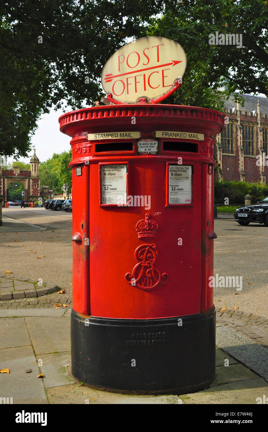 A red British pillar box with two apertures, one for stamped, one for franked, mail, London, England. From reign Stock Photo