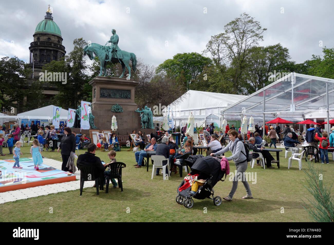 People in the gardens of the Edinburgh International Book Festival - Stock Image