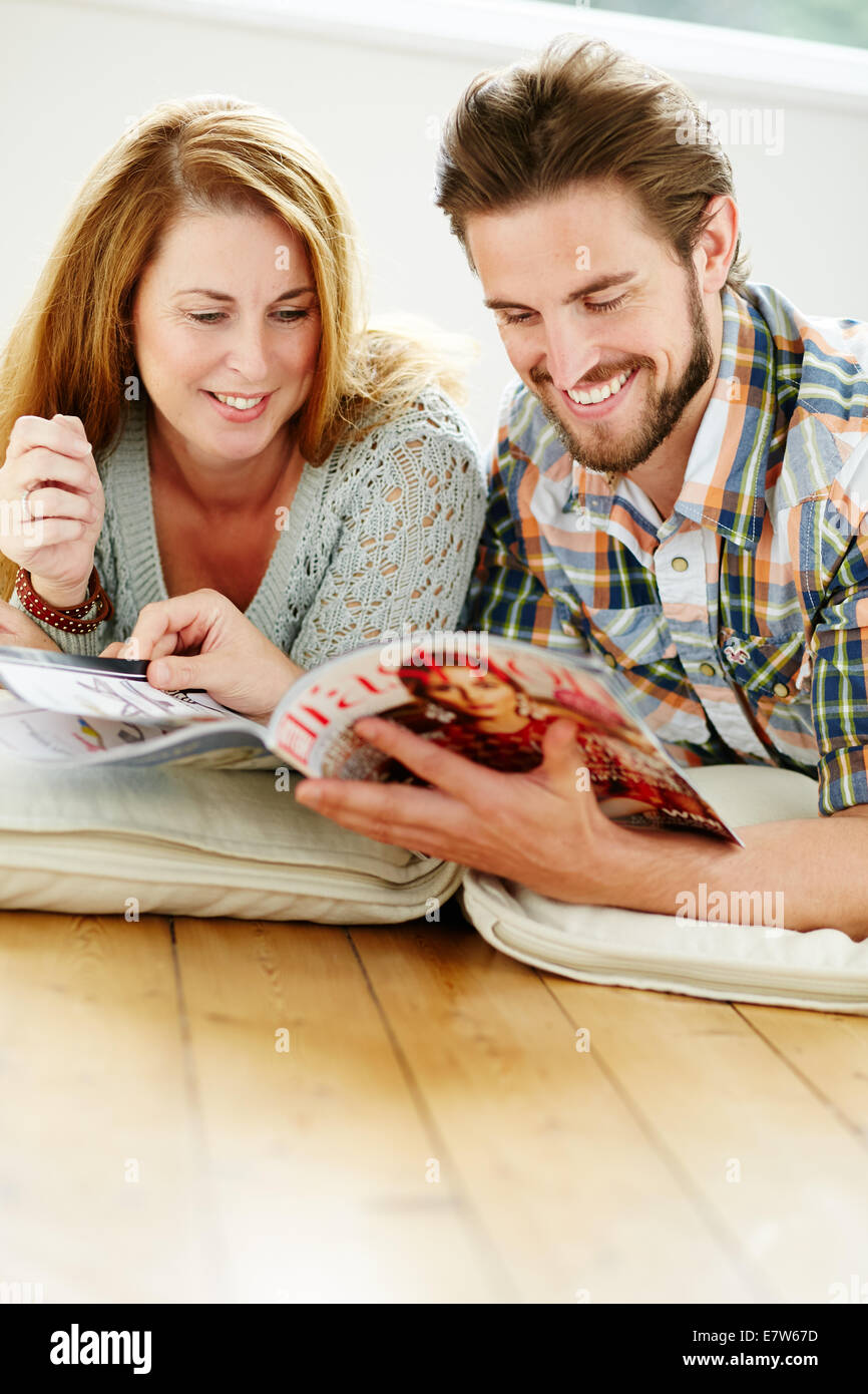 Couple relaxing indoors Stock Photo