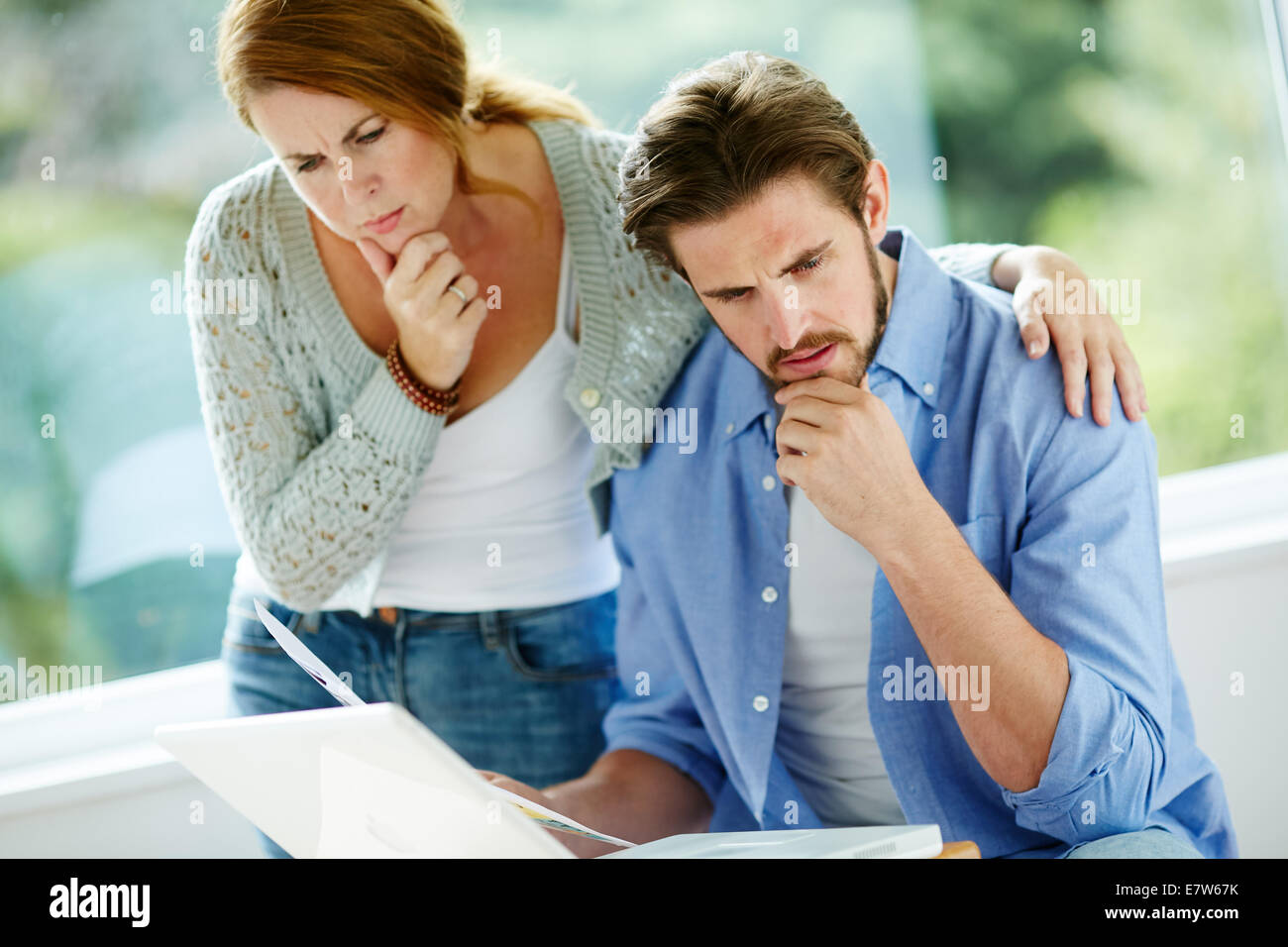 Couple working out finances - Stock Image