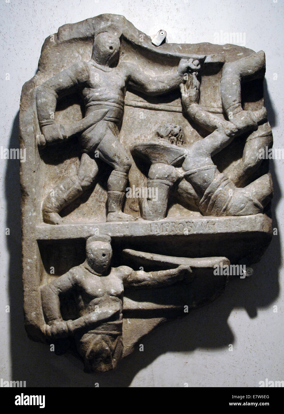 Fragment of a commemorative relief of an unknown gladiator's ventures. 1st century B.C. Roman National Museum. - Stock Image