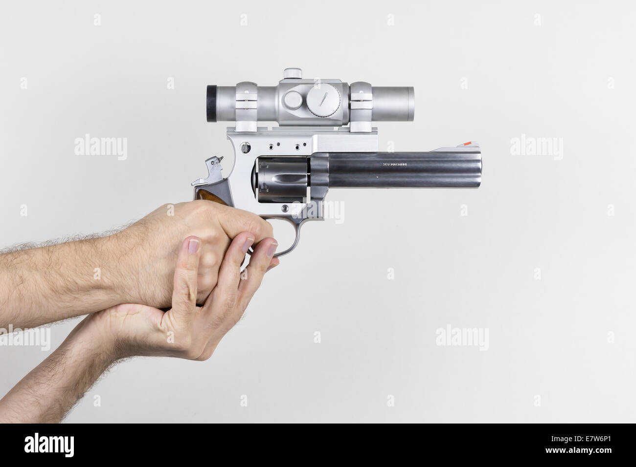 Shooter holds .357 Magnum revolver with dot sight - Stock Image