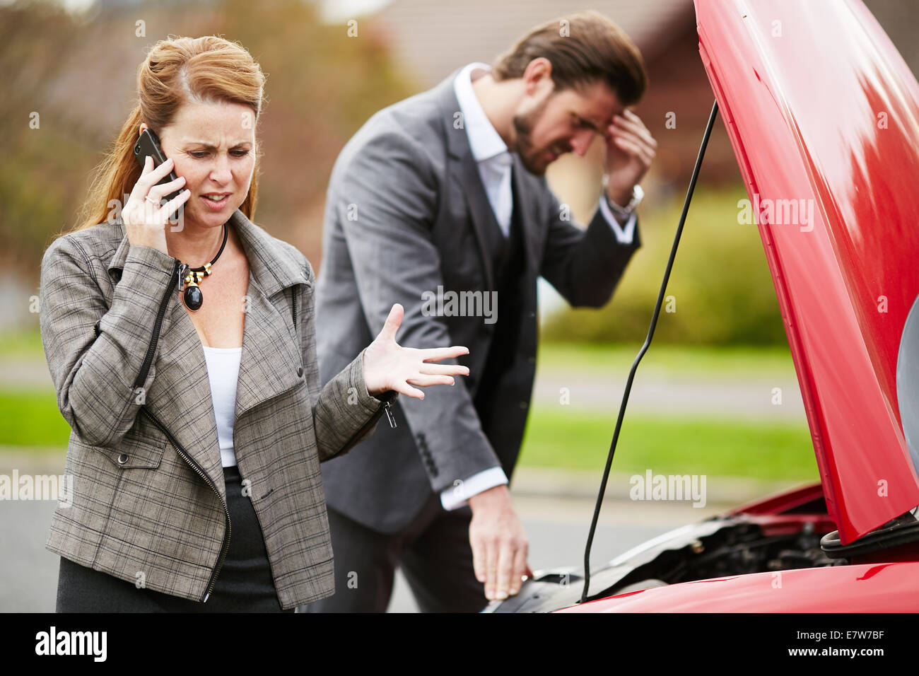 Couple with broken down car - Stock Image