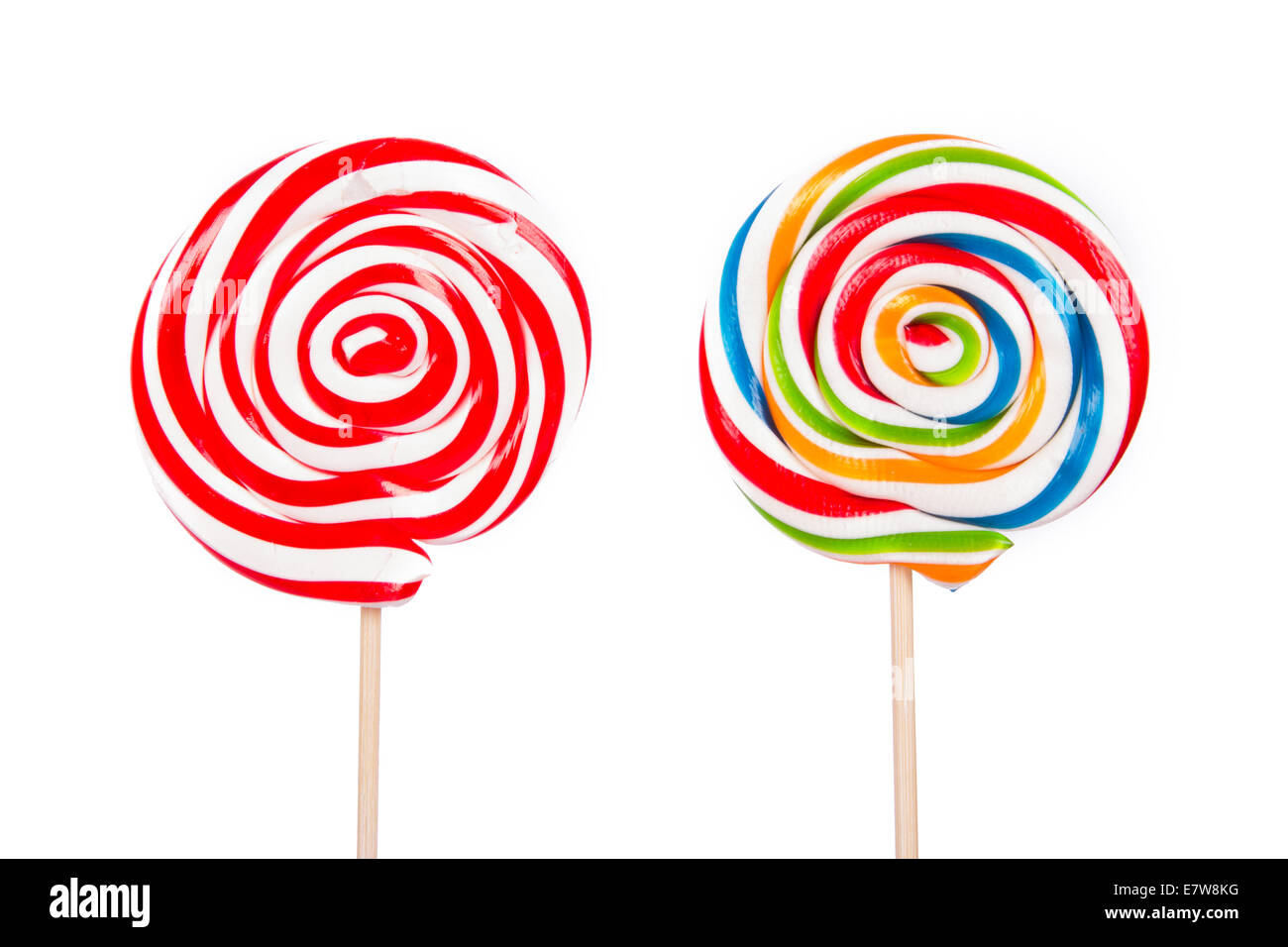 Colorful spiral lollipop candy on stick, isolated on white background. - Stock Image