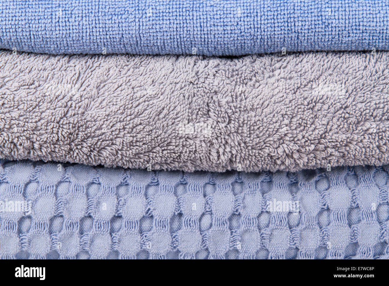 Blue stacked bathroom towels. - Stock Image