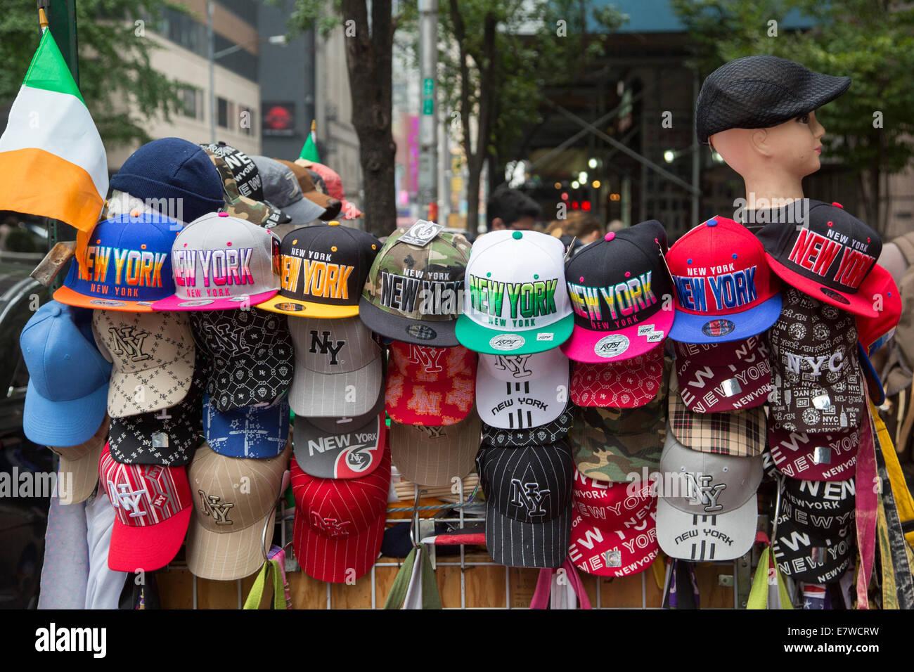 New York, New York - Baseball caps on sale at a street vendor's stall in midtown Manhattan. - Stock Image