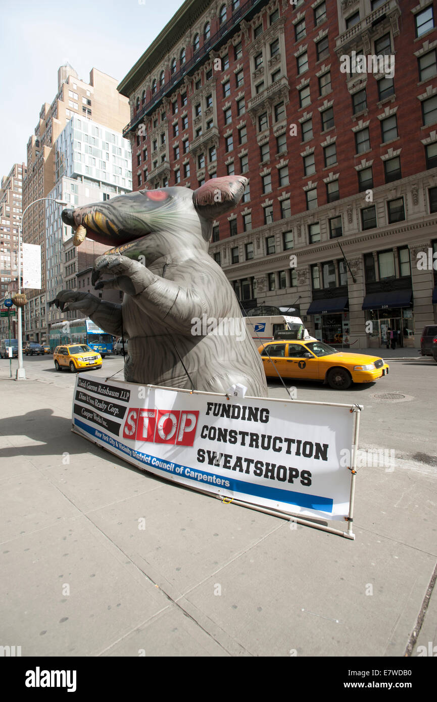 STOP Funding Construction Sweat Shops - Stock Image