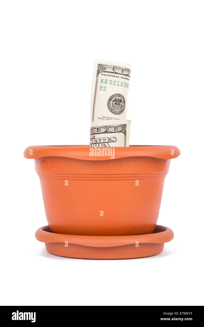 Flower pot and full of soil with one hundred dollar bills inside, front view, isolated on white background. - Stock Image
