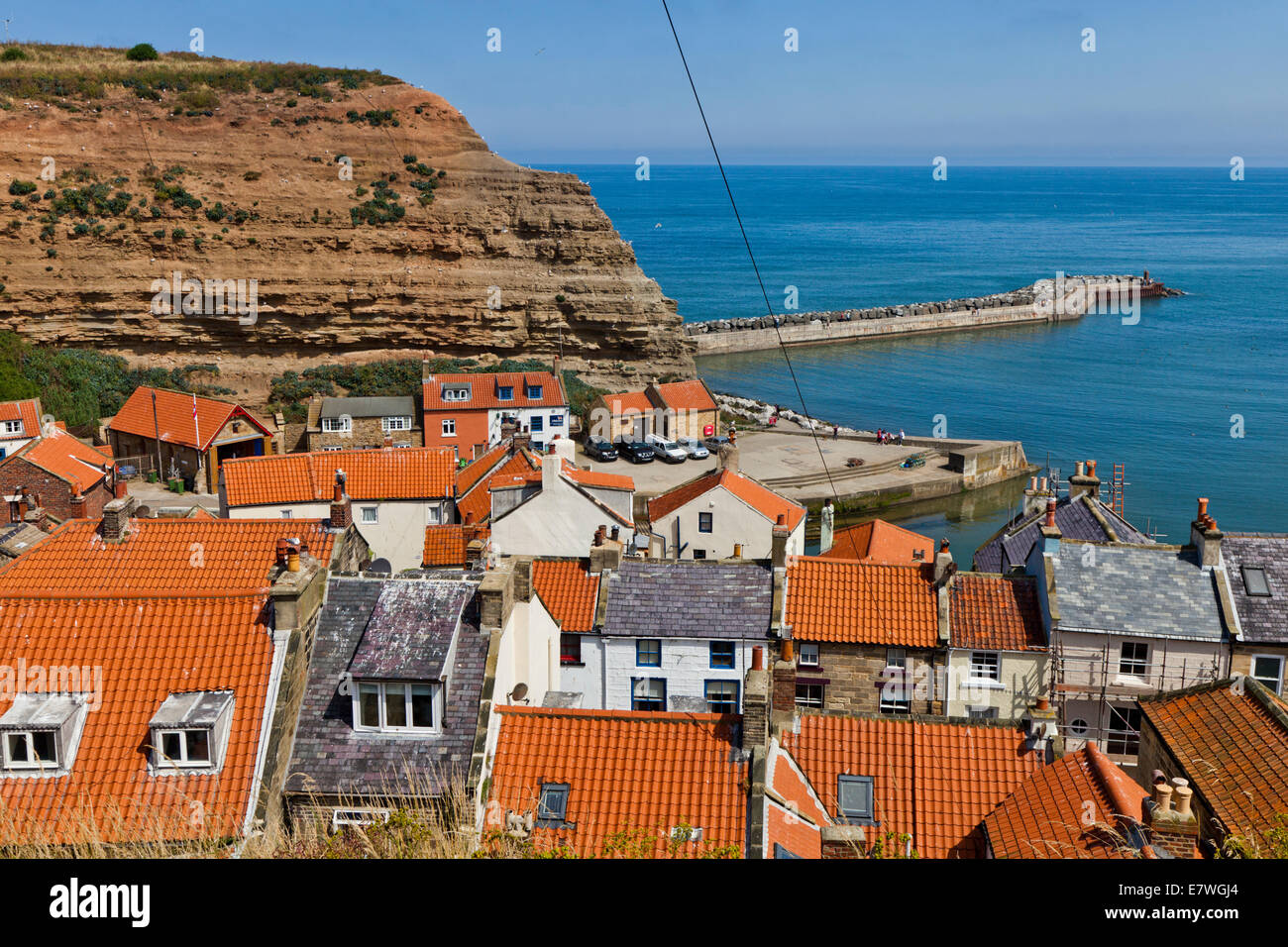A bright sunny day in the village of Staithes North Yorkshire - Stock Image