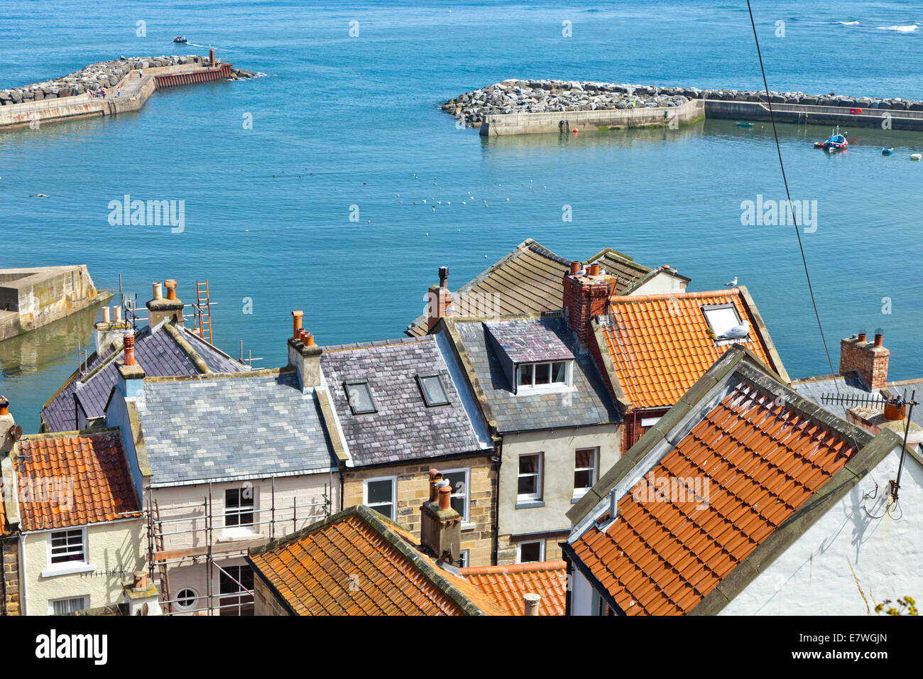 The harbour on a bright sunny day in the village of Staithes North Yorkshire - Stock Image