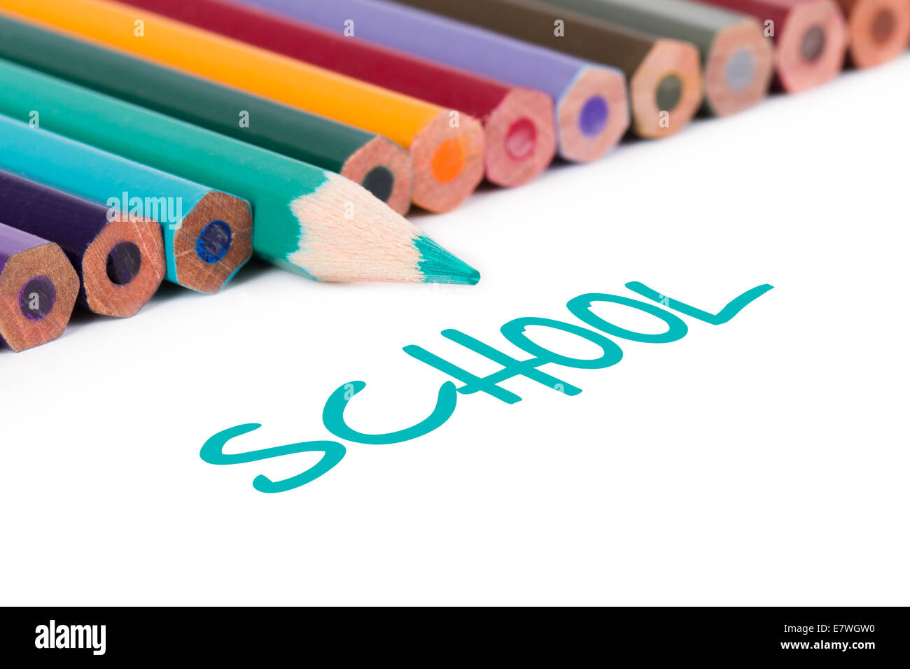 Colorful pencils with school text, isolated on white background. - Stock Image