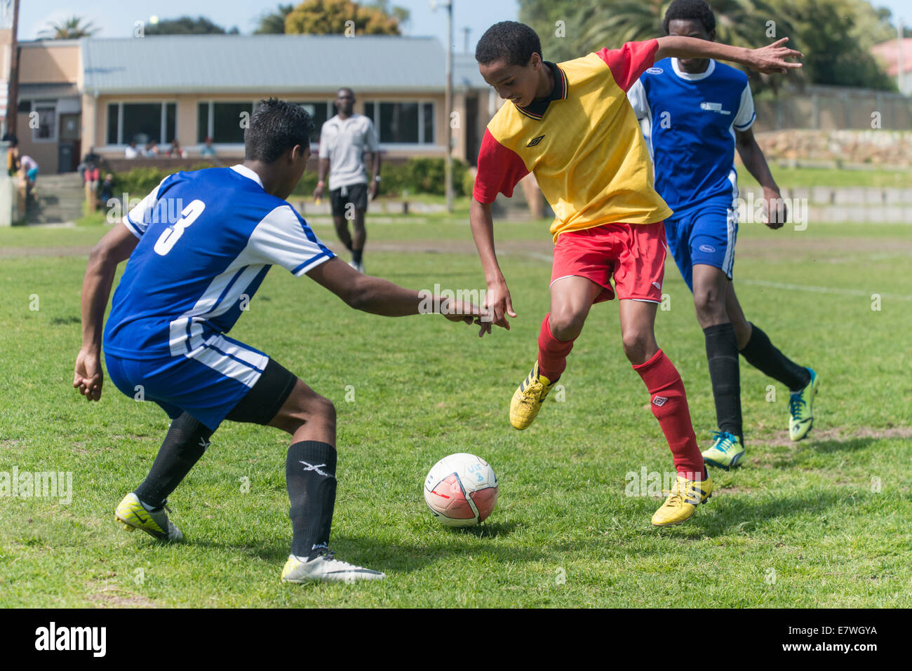 Young football players dribbling for the ball, Cape Town, South Africa - Stock Image