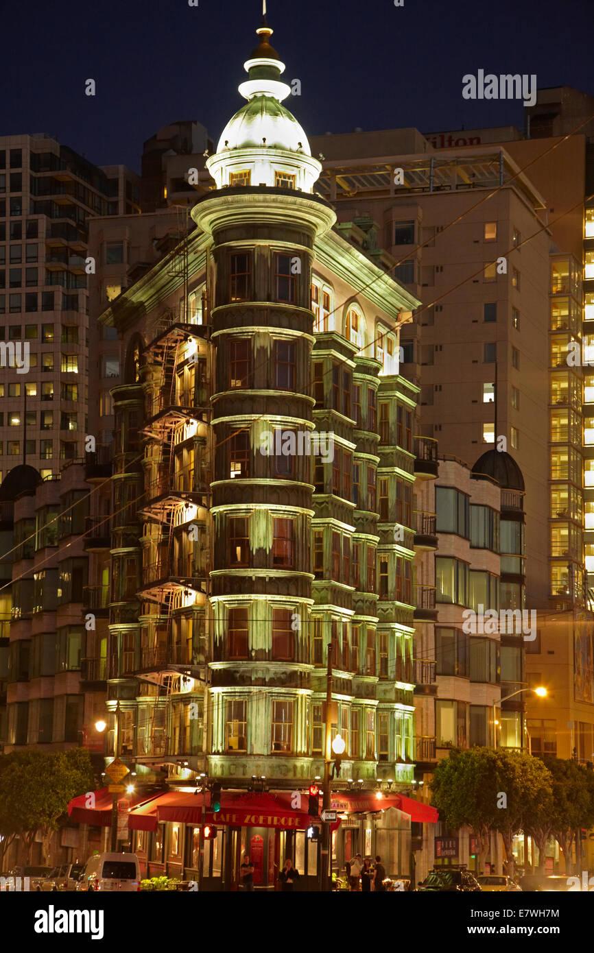 Columbus Tower (aka Sentinel Building, 1907) at night, downtown San Francisco, California, USA Stock Photo