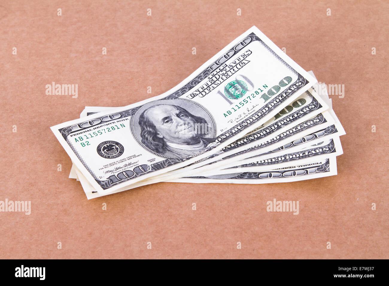 Money concept, one hundred dollar bills on cork board. - Stock Image