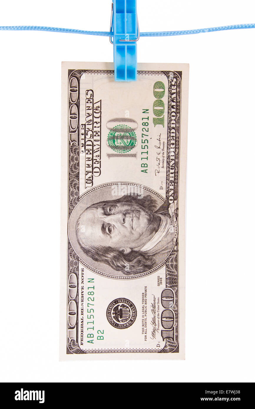 One hundred dollar bill with  blue clothespin, isolated on white background. - Stock Image