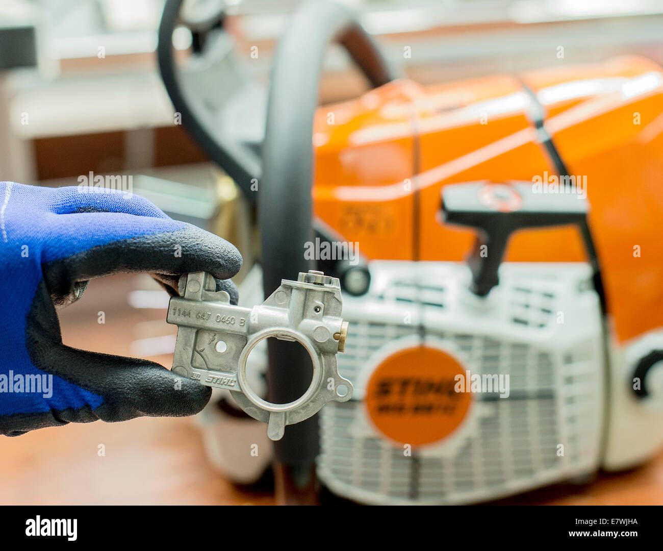 Waiblingen germany 24th sep 2014 an employee of chainsaw an employee of chainsaw producer stihl shows a pump to put sticking oil onto the chain of a chainsaw in waiblingen germany 24 september 2014 keyboard keysfo Image collections