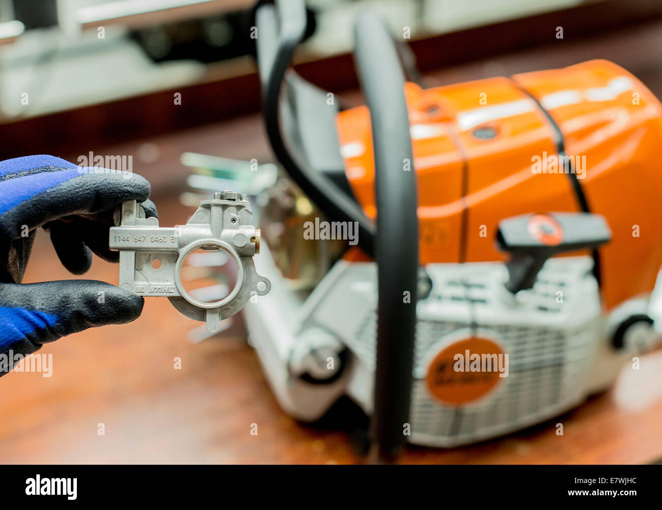 Waiblingen germany 24th sep 2014 an employee of chainsaw an employee of chainsaw producer stihl shows a pump to put sticking oil onto the chain of a chainsaw in waiblingen germany 24 september 2014 keyboard keysfo Choice Image