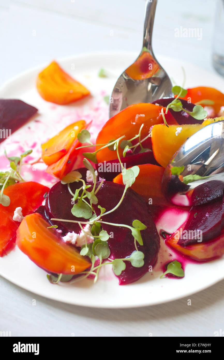 Yellow, orange, and red beet salad - Stock Image