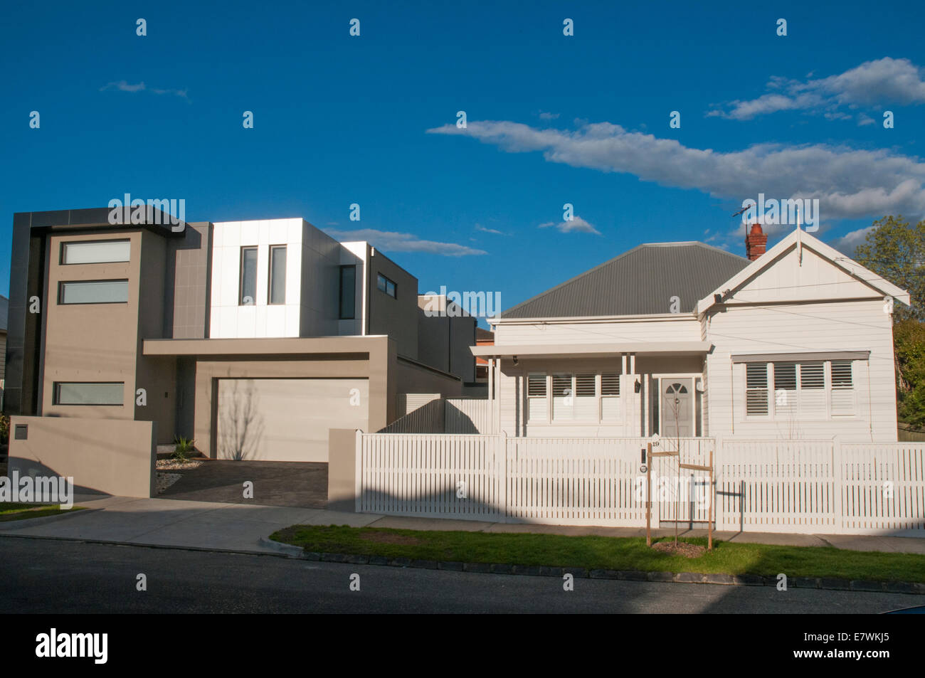 A starkly angular moden home clashes with older (Edwardian) architectural styles in the Melbourne suburb of Caulfield - Stock Image