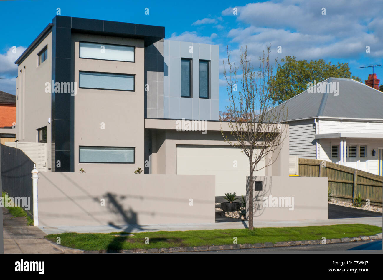 A starkly angular modern home clashes with older (Edwardian) architectural styles in the Melbourne suburb of Caulfield - Stock Image