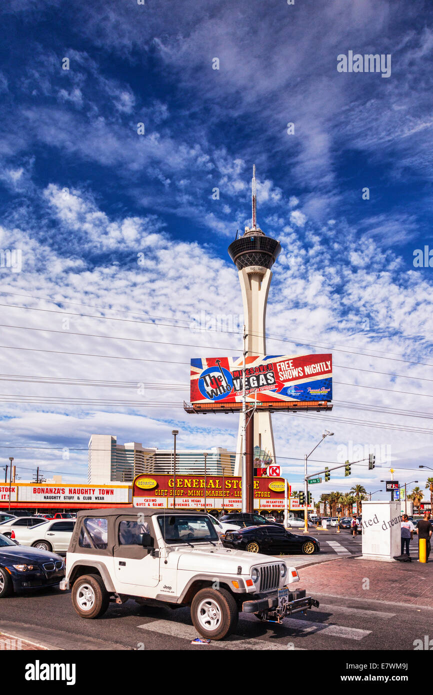 Las Vegas the Stratosphere casino and tower, with a jeep in the forground. - Stock Image