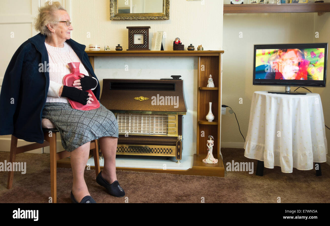 ninety year old lady wearing gloves and holding hot water bottle